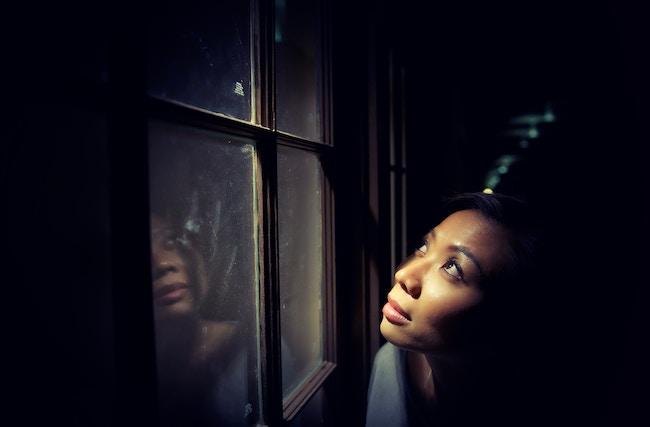 woman_looking_up_window.jpg